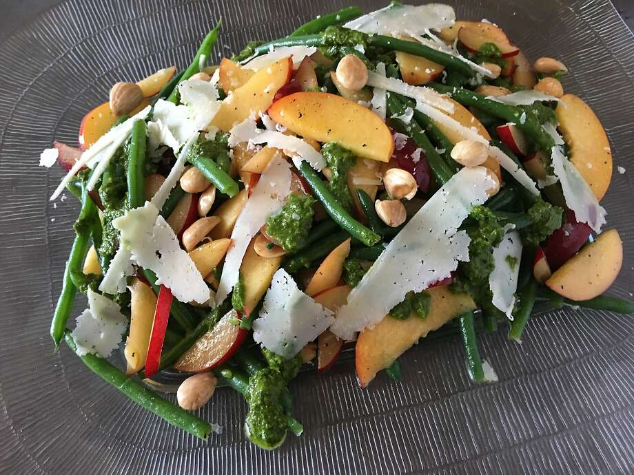 Stone fruit salad with green beans, pesto, marcona almonds and shaved pecorino Romano. Photo: Sarah Fritsche