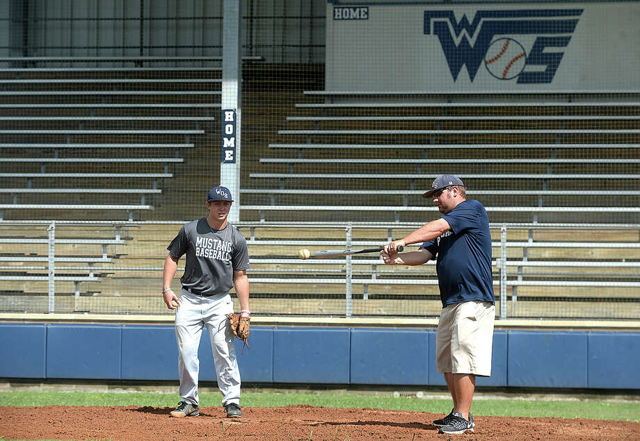 West Orange - Stark's Jack Dallas assists head coach Shea Landry add he bats grounders to the infield during practice after school Tuesday to prepare for their 1 series playoff game Thursday against Waco Robinson. Photo taken Tuesday, May 23, 2017 Kim Brent/The Enterprise Photo: Kim Brent / BEN