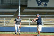 West Orange - Stark's Jack Dallas assists head coach Shea Landry add he bats grounders to the infield during practice after school Tuesday to prepare for their 1 series playoff game Thursday against Waco Robinson. Photo taken Tuesday, May 23, 2017 Kim Brent/The Enterprise