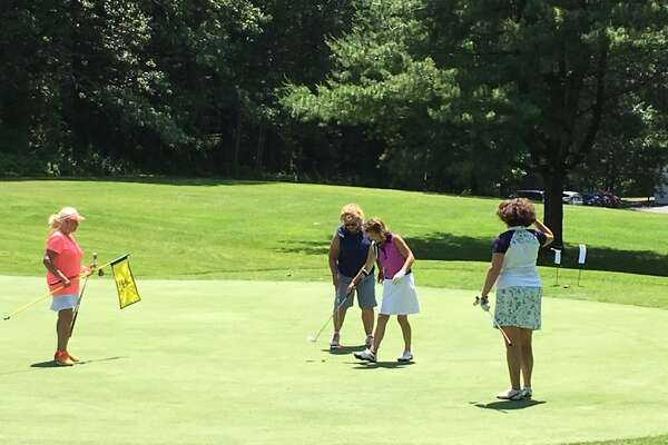 Women play the 9th green at Pinehaven Country Club on Sunday, June 18, 2017. The club has shortened the yardage for women as part of its Play It Forward initiative. (Provided)