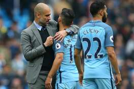 MANCHESTER, ENGLAND - MAY 13:  Josep Guardiola, Manager of Manchester City and Sergio Aguero of Manchester City embrace after the Premier League match between Manchester City and Leicester City at Etihad Stadium on May 13, 2017 in Manchester, England.  (Photo by Alex Livesey/Getty Images)