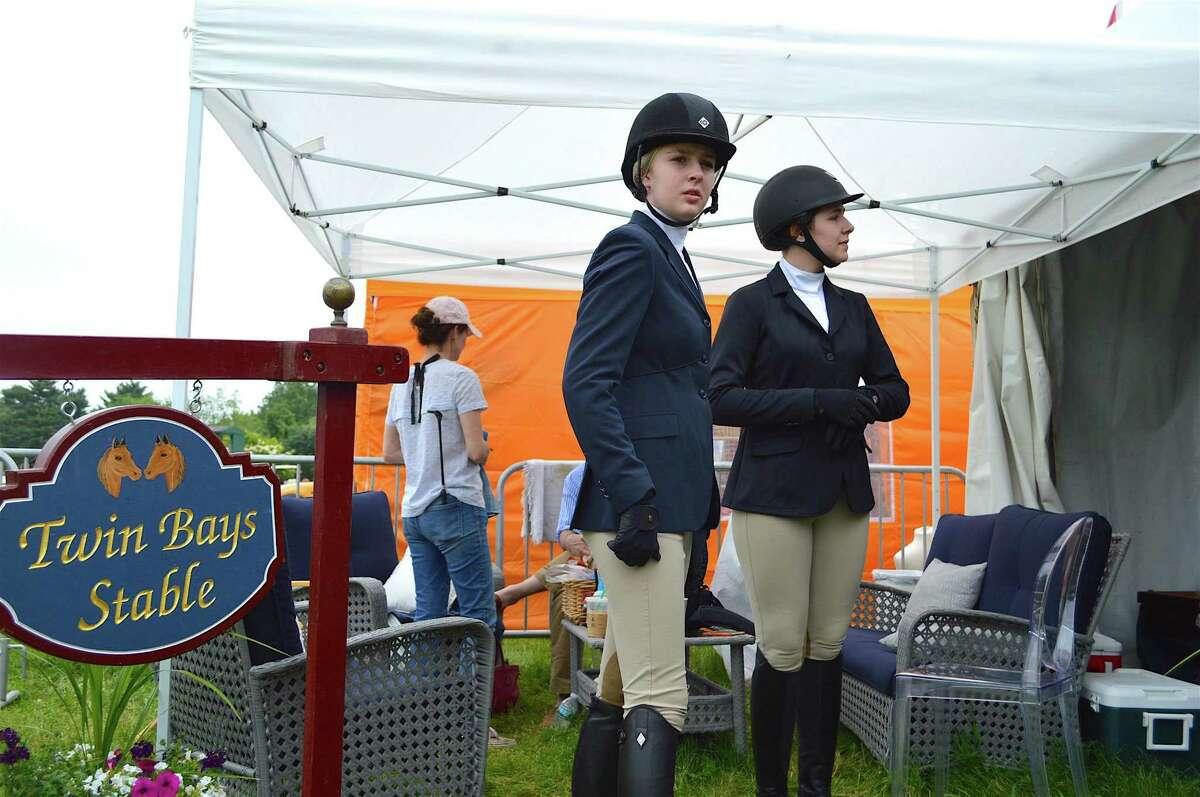 Annie Salvi, 14, of Darien, left, and Sarah Bibb, 15, of Wilton, get ready to ride at the Ox Ridge Hunt Club's June Horse Show, Saturday, June 17, 2017, in Darien, Conn.
