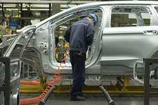 FILE-- The body shop at a Ford plant in Hangzhou, China, April 11, 2017. Ford Motor said June 20 that it would build its next-generation small car, the Focus, for American consumers in China rather than Mexico, where the automaker canceled plans for a new factory earlier this year. (Giulia Marchi/The New York Times)
