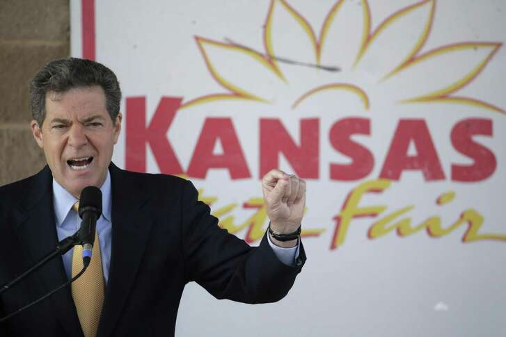 Republican Gov. Sam Brownback participates in a debate at the Kansas State Fair in 2014. A downturn in the state economy is not due to the trickle-down economics the governor favors.