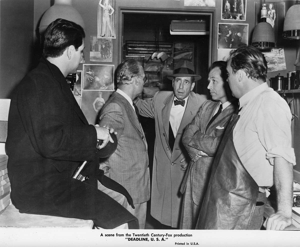 "Humphrey Bogart (center) in ""Deadline U.S.A.,"" part of the 2009 Noir City Festival."