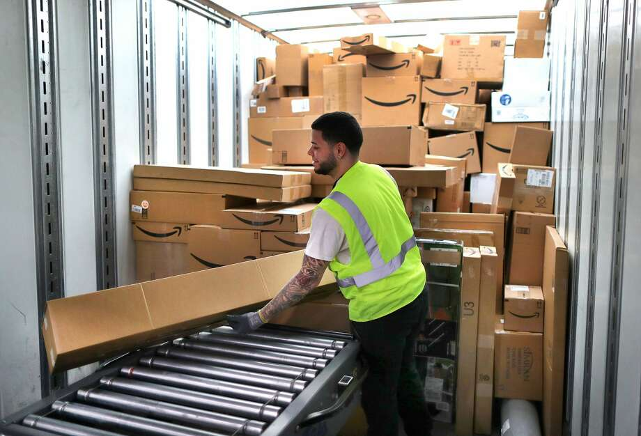 FALL RIVER, MA - MARCH 23: A worker loads customer orders into a waiting tractor-trailer inside the million-square foot Amazon distribution warehouse that opened last fall in Fall River, MA on Mar. 23, 2017. (Photo by John Tlumacki/The Boston Globe via Getty Images) Photo: Boston Globe/Boston Globe Via Getty Images