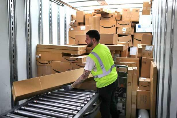 FALL RIVER, MA - MARCH 23: A worker loads customer orders into a waiting tractor-trailer inside the million-square foot Amazon distribution warehouse that opened last fall in Fall River, MA on Mar. 23, 2017. (Photo by John Tlumacki/The Boston Globe via Getty Images)