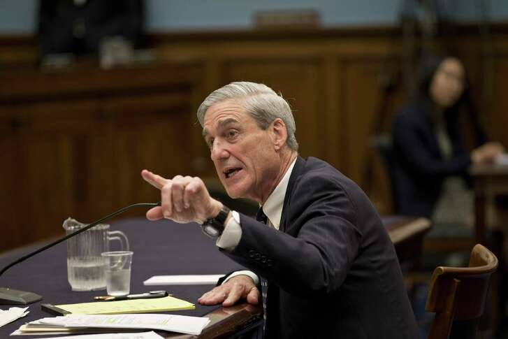FILE - In this June 13, 2013 file photo, then-FBI Director Robert Mueller testifies on Capitol Hill in Washington. Now a special counsel, Mueller is reportedly running a three-pronged investigation — into possible collusion between Russians and members of Trump's campaign team, obstruction of justice by President Trump and any money crimes by Trump associates.
