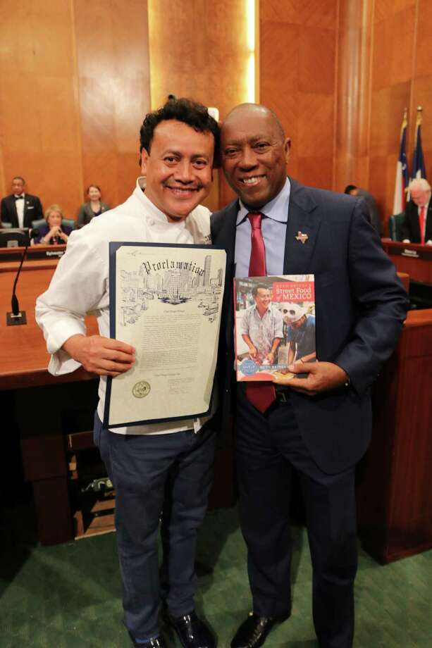 Chef Hugo Ortega receives a proclamation from Mayor Sylvester Turner declaring June 20 Chef Hugo Ortega Day in Houston. Photo: Paula Murphy