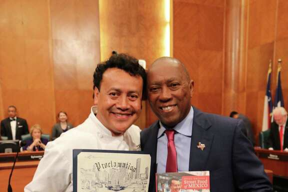 Chef Hugo Ortega receives a proclamation from Mayor Sylvester Turner declaring June 20 Chef Hugo Ortega Day in Houston.