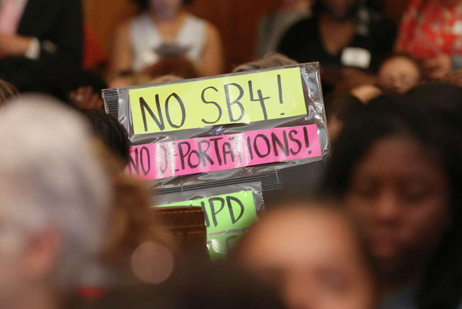 People attended City Council meeting with signs opposing Senate Bill 4 at City Hall Tuesday, June 20, 2017, in Houston. Photo: Godofredo A. Vasquez, Houston Chronicle / Godofredo A. Vasquez