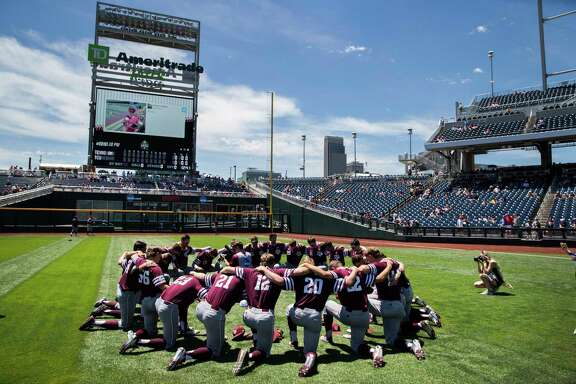 Texas A&M players gather in a huddle prior to game 7 of the College World Series against TCU in an NCAA College World Series baseball elimination game in Omaha, Neb., Tuesday, June 20, 2017. (Brendan Sullivan/Omaha World-Herald via AP)