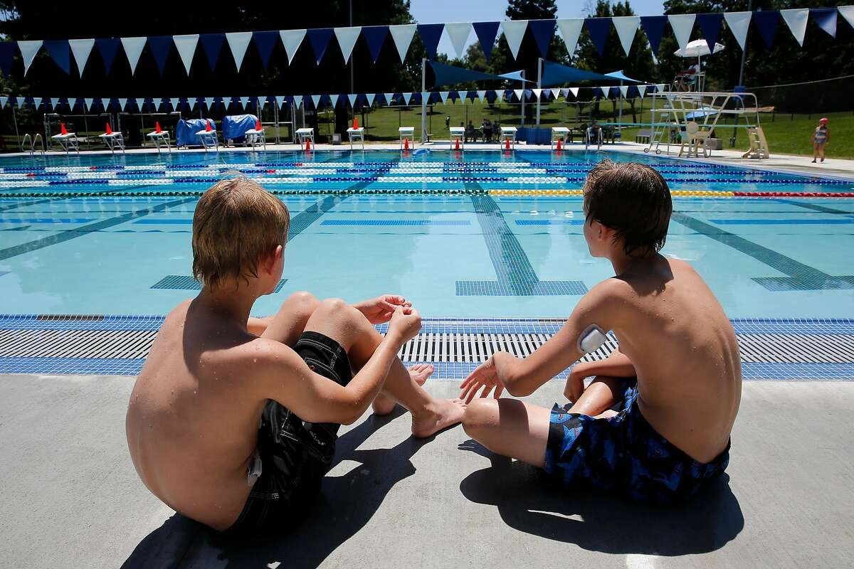 Twins Aidan, (left) and William Gailmard both 11-years -old of Walnut Creek wait for the pool to reopen at the Larkey Park swim center, which had to be shut down after several power outages, in Walnut Creek, Ca., on Tuesday June 20, 2017. Keep clicking for the best day trips to escape the Bay Area heat.