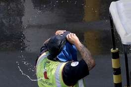 An American Airlines grounds crew member at Sky Harbor International Airport puts on a wet hat to combat the heat, Tuesday, June 20, 2017 in Phoenix. Phoenix hit a high of 118 on Monday with an excessive heat warning in place until Saturday. (AP Photo/Matt York)