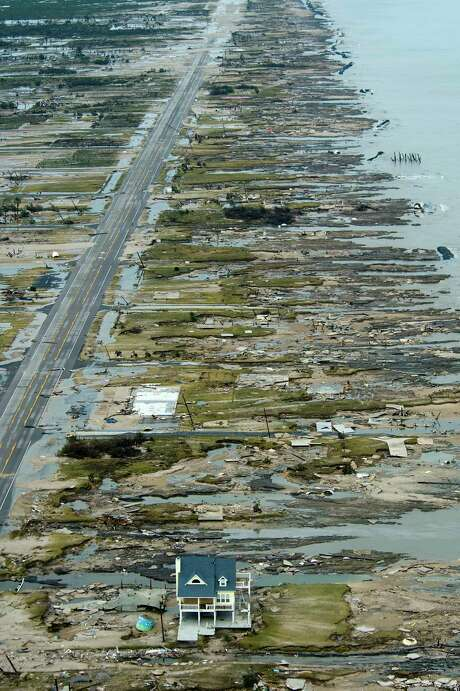 A single house is left standing amidst the devastation left by Hurricane Ike, Sunday, Sept. 14, 2008, in Gilchrist, Texas. ( Smiley N. Pool / Chronicle ) (12/28 pg A1)    Warren and Pam Adams house is left standing amidst the devastation left by Hurricane Ike in Gilchrist. Photo: Smiley N. Pool, Staff / Houston Chronicle