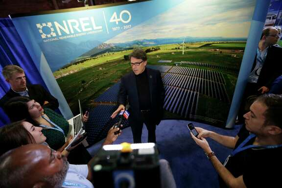 FILE - In this April 21, 2017 file photo, Energy Rick Perry speaks to reporters at an Earth Day display at Fair Park in Dallas. Since becoming President Donald Trump's energy secretary,   (AP Photo/LM Otero, File)