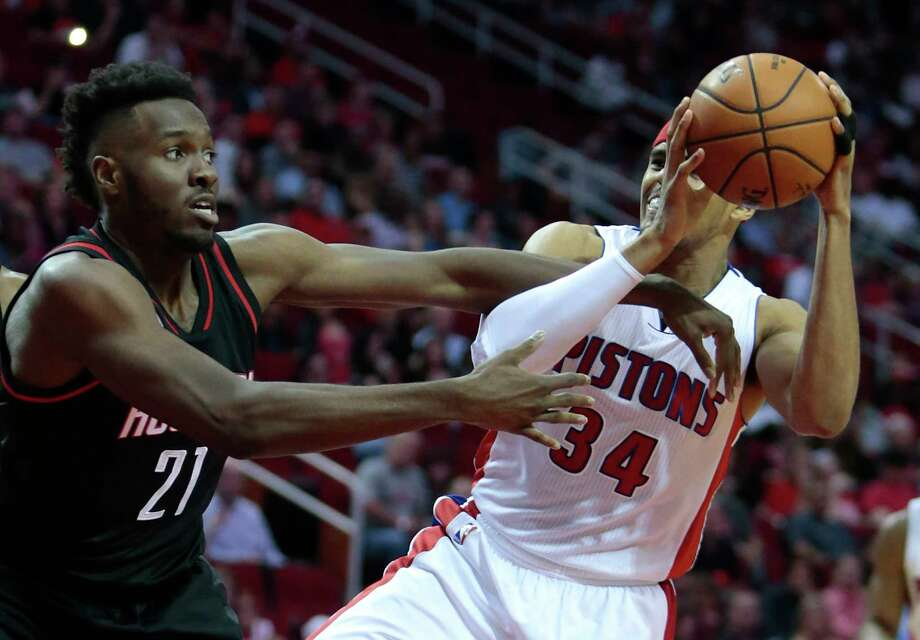Houston Rockets forward Chinanu Onuaku (21) defends a drive to the basket by Detroit Pistons forward Tobias Harris (34) during the third quarter of an NBA basketball game at Toyota Center on Friday, April 7, 2017, in Houston. ( Brett Coomer / Houston Chronicle ) Photo: Brett Coomer, Staff / © 2017 Houston Chronicle
