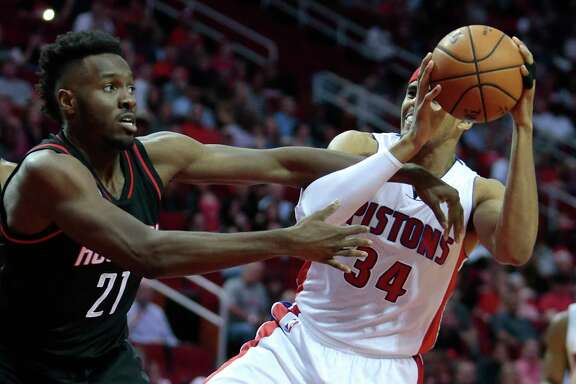 Houston Rockets forward Chinanu Onuaku (21) defends a drive to the basket by Detroit Pistons forward Tobias Harris (34) during the third quarter of an NBA basketball game at Toyota Center on Friday, April 7, 2017, in Houston. ( Brett Coomer / Houston Chronicle )