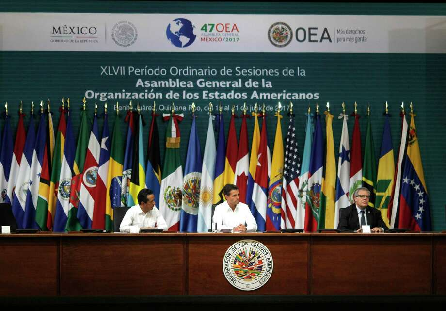 The 2017 OAS General Assembly is meeting this week in Cancun, Mexico. U.S. lawmakers question the  role of the OAS in shaping social policies in Latin American nations. Photo: Israel Leal, STR / Copyright 2017 The Associated Press. All rights reserved.