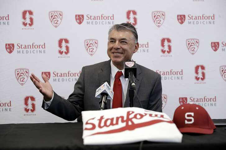 David Esquer fields questions during a press conference introducing him as the new head coach of the Stanford NCAA college baseball team Tuesday, June 20, 2017, in Stanford, Calif. (AP Photo/Marcio Jose Sanchez)