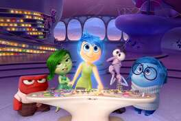 "In this image released by Disney-Pixar, characters, from left, Anger, voiced by Lewis Black, Disgust, voiced by Mindy Kaling, Joy, voiced by Amy Poehler, Fear, voiced by Bill Hader, and Sadness, voiced by Phyllis Smith appear in a scene from ""Inside Out."" The film was nominated for a Golden Globe award for best animated film on Thursday, Dec. 10, 2015. The 73rd Annual Golden Globes will be held on Jan. 10, 2016. (Disney-Pixar via AP)"