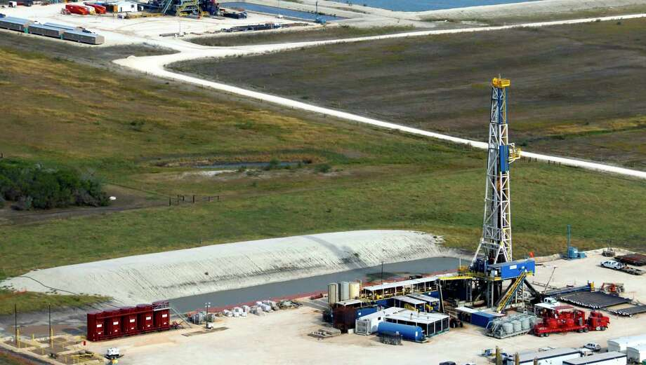 In this 2012 photo drilling rigs dot the landscape of the Eagle Ford Shale in South Texas. While the Eagle Ford Shale oil field was hit hard by the downturn in oil prices in 2014 and 2015, the West Texas' prolific Permian Basin saw continued increases in production. Photo: San Antonio Express-News / © 2012 San Antonio Express-News