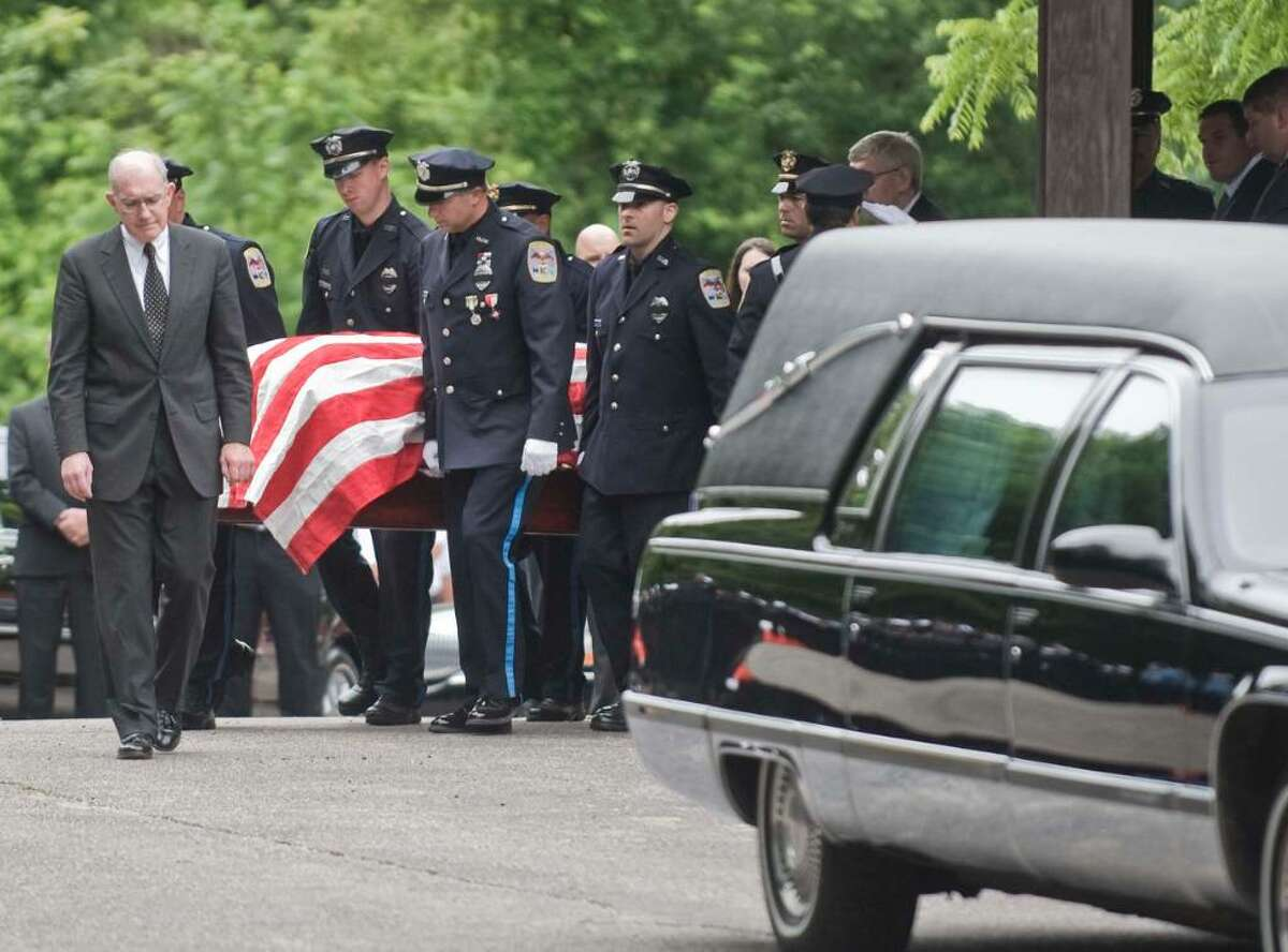 Danbury Police Officer Donald Hassiak is carried out of the church by Danbury police at the closing of the funeral at St. Francis Xavier Roman Catholic Church in New Milford. Wednesday, June 9, 2010