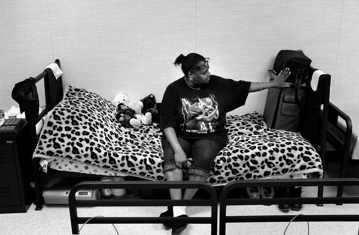 Denise Ward sitting on he bed in the dormatory, is one of the first residents to move into the newly opened Dogpatch Navigation Center in San Francisco, Ca., as seen on Monday June 19, 2017.
