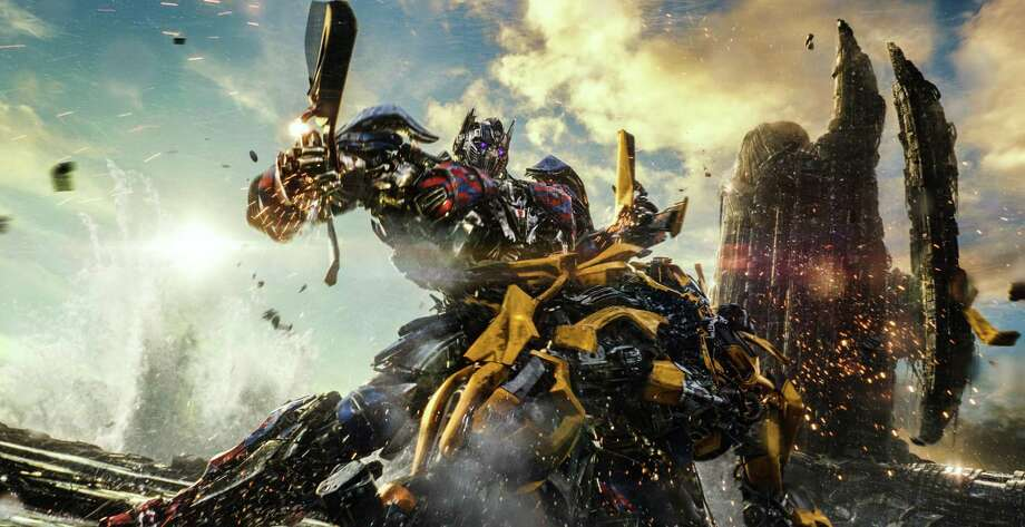 "Why are Optimus Prime and Bumblebee fighting? The answer is contained in ""Transformers: The Last Knight."" Photo: Paramount Pictures / TNS"