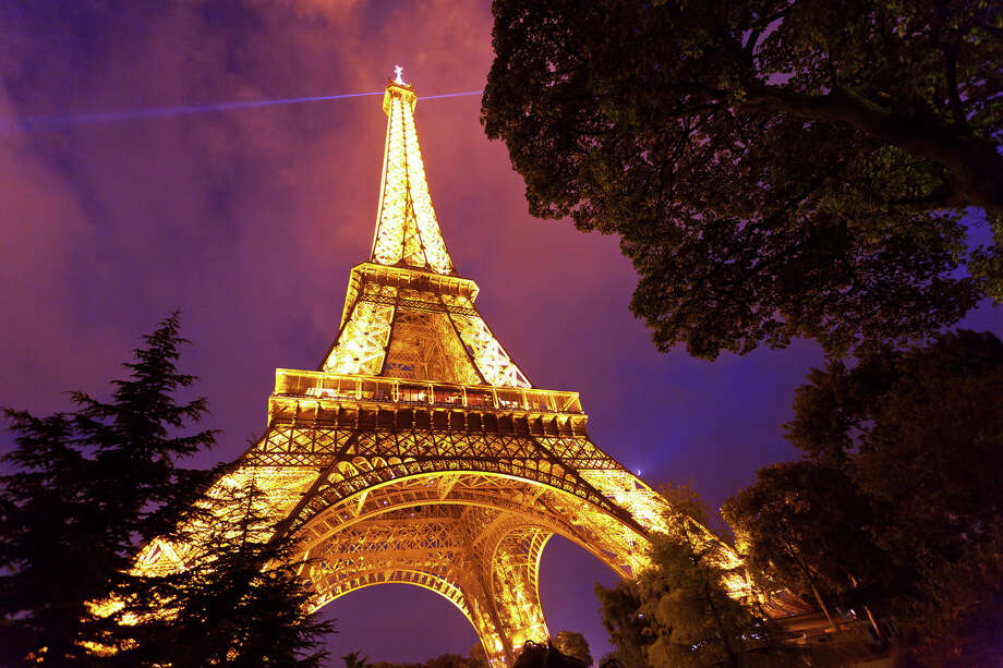 For an unforgettable evening in Paris, hire a cab or use a ride-sharing app to take a personal tour of floodlit monuments, such as the Eiffel Tower. Photo: Dominic Arizona Bonuccelli / dominic arizona bonuccelli / azfoto.com