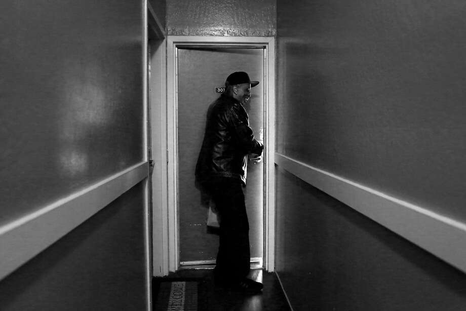 Harold Haynie unlocks the front door to his room at the Hamlin Hotel, which used to be Luis Castellanos' room before he got his own apartment. Photo: Lea Suzuki, The Chronicle