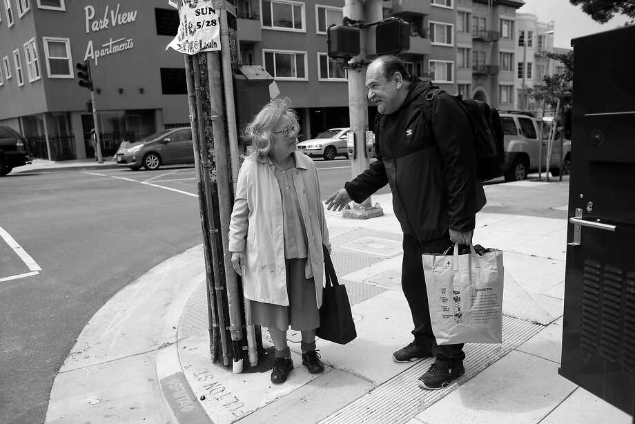 Luis Castellanos (right) stops to talk to Joanne Yee as they cross paths in the Richmond District. Castellanos knows Yee from a drop-in help center that he used to visit when he was homeless. Photo: Lea Suzuki, The Chronicle