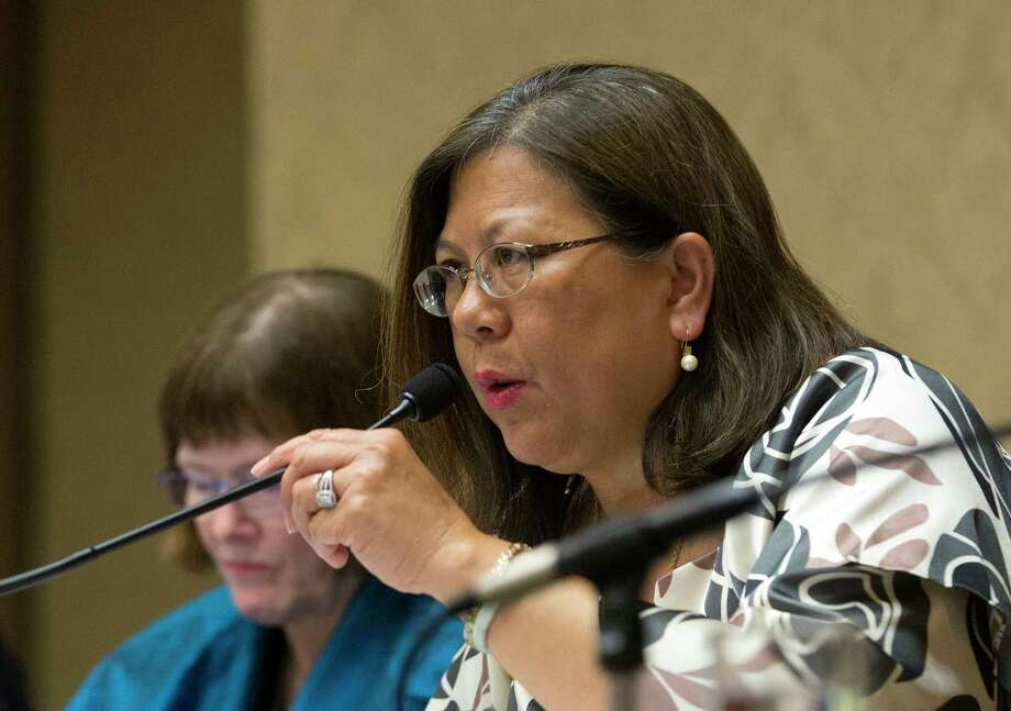 File - In this June 28, 2016, file photo, California Controller Betty Yee listens during a meeting in Sacramento, Calif. As controller, Yee is the fifth voting member of the state Board of Equalization. Investigators from the California Department of Justice have interviewed staff members at the troubled state agency that collects more than $60 billion in taxes, which lawmakers voted last week to break up, officials confirmed Tuesday, June 20, 2017. Civil servants and executives from the Board of Equalization have spoken with investigators, a board spokesman confirmed. (AP Photo/Rich Pedroncelli, File) Photo: Rich Pedroncelli, STF / Copyright 2016 The Associated Press. All rights reserved. This material may not be published, broadcast, rewritten or redistribu