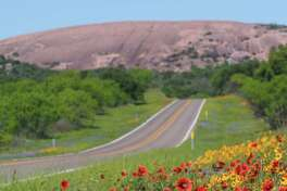 The road to Enchanted Rock State Park near Fredericksburg is lined with wildflowers in the springtime.
