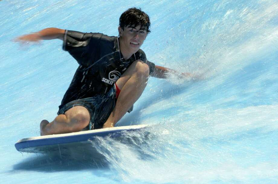 A competitor in the Boogie Bahn Classic Surf Competition has a smooth wide on the waves at the Schlitterbahn Waterpark in New Braunfels. Photo: Express-News File Photo / © 2014 San Antonio Express-News