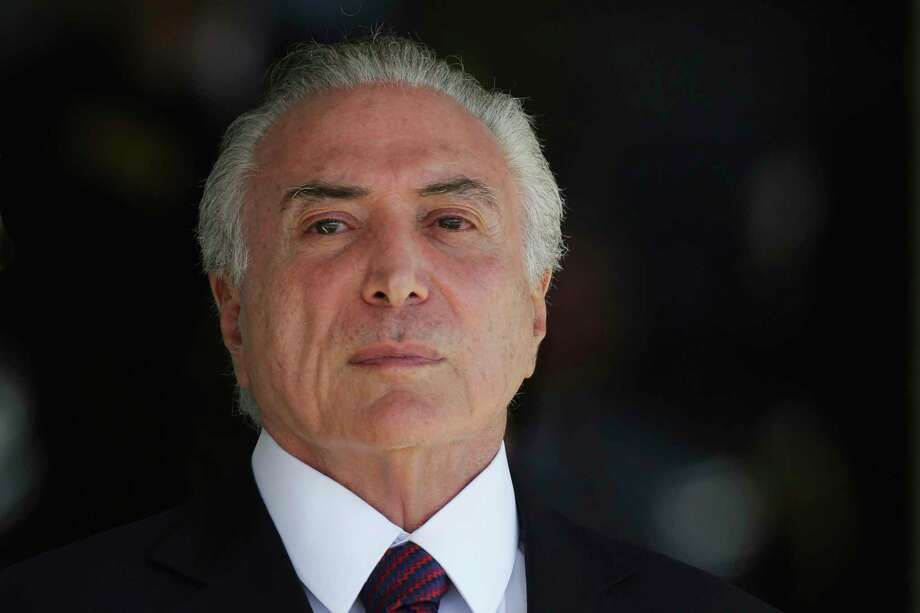 FILE - In this June 9, 2017 file photo, Brazil's President Michel Temer attends a military ceremony in Brasilia, Brazil. Brazil's federal police force says it has found evidence that Temer received bribes to help businesses. Investigators said in a preliminary report published Tuesday, June 20, 2017, by Brazil's top court that Temer deserves to be investigated for corruption. Temer has denied any wrongdoing and has already pledged not to resign. (AP Photo/Eraldo Peres, File) Photo: Eraldo Peres, STF / Copyright 2017 The Associated Press. All rights reserved.