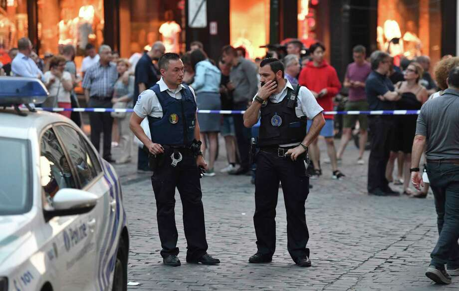 Belgian police stand in front of a police cordon as people are evacuated at the Grand Place square near Central Station in Brussels after a reported explosion on Tuesday, June 20, 2017. Belgian media are reporting that explosion-like noises have been heard at a Brussels train station, prompting the evacuation of a main square. (AP Photo/Geert Vanden Wijngaert) Photo: Geert Vanden Wijngaert, STR / Copyright 2017 The Associated Press. All rights reserved.