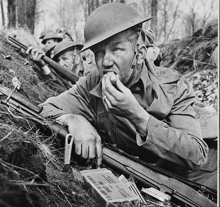 U.S. soldier eating field ration in 1942.