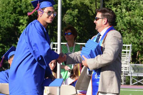 Kyle Lyra receives his diploma during Danbury High Schools Commencement Exercises that were held on Tuesday June 20, 2017.