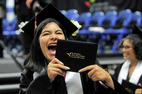 Graduate Eveana Mercado cheers as she shows her family her diploma during The Interdistrict Science Magnet School's Second Annual Commencement held at the Webster Bank Arena in Bridgeport, Conn., on Tuesday June 20, 2017.
