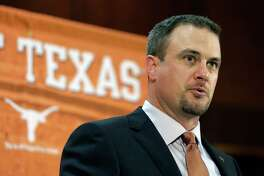 FILE - In this Nov. 27, 2016, file photo, Tom Herman talks to the media during a news conference where he was introduced as coach of the Texas college football team. Considering all the hype about Herman, there will not be much of a grace period for him in Austin. Former coach Charlie Strong left behind a pretty good roster and told the world that the Longhorns would win 10 games in 2017 no matter who is coaching. (AP Photo/Eric Gay, File)
