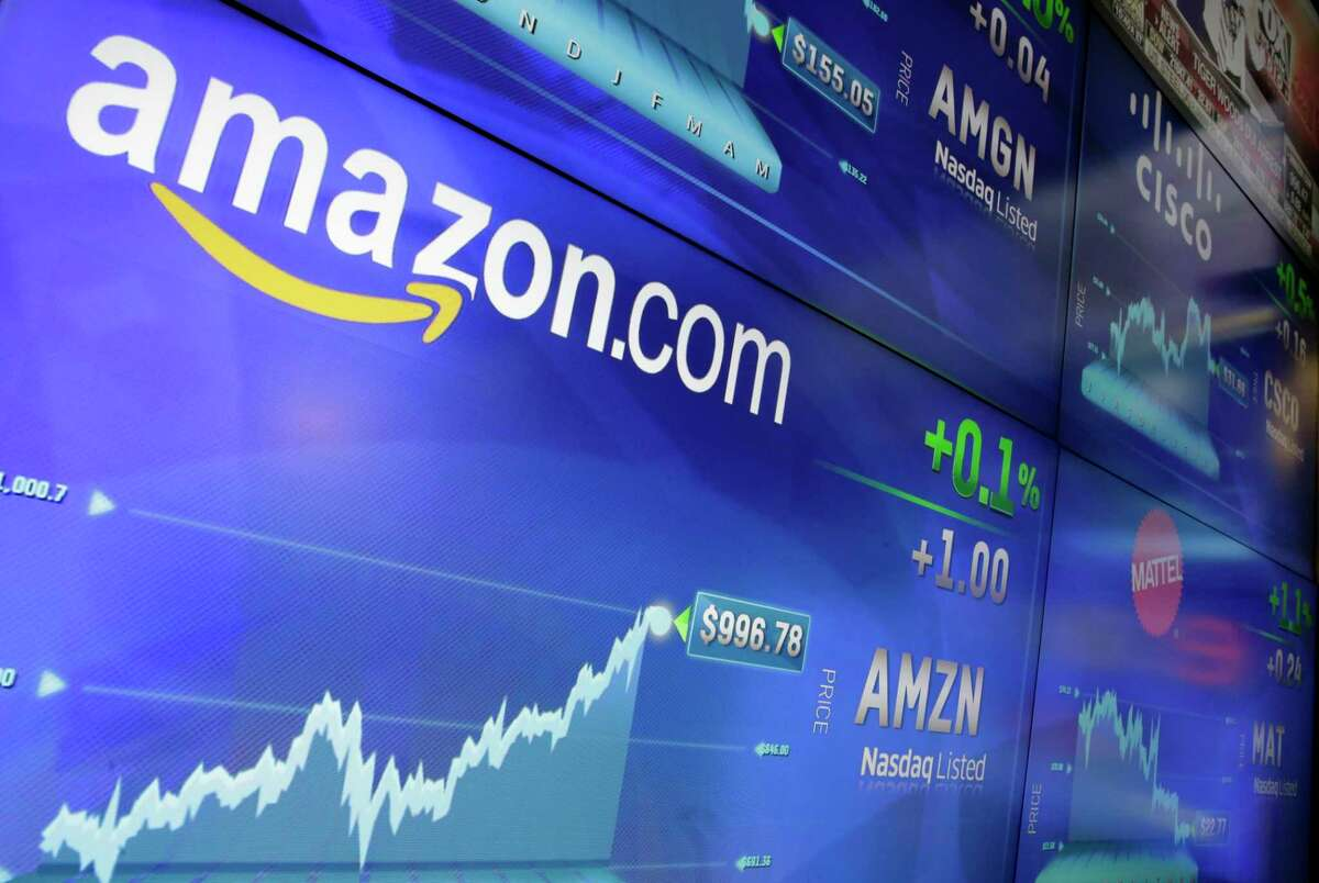 FILE - In this Tuesday, May 30, 2017, file photo, the Amazon logo is displayed at the Nasdaq MarketSite, in New York's Times Square. Amazon announced Tuesday, June 20, 2017, that itÂ?'s testing a new service for its Prime members that lets customers try on the latest styles before they buy at no upfront charge, take seven days to decide and only pay for what they keep. (AP Photo/Richard Drew, File)