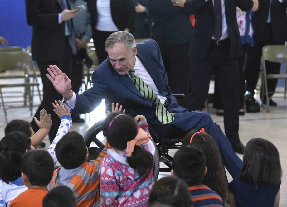 Texas Gov. Greg Abbott gives high-fives to children at Barrera Veterans Elementary School in the Somerset Independent School District earlier this year. Photo: Billy Calzada /San Antonio Express-News / San Antonio Express-News
