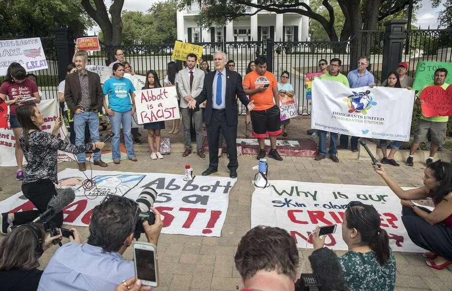 """U.S Rep. Lloyd Doggett speaks during a protest outside of the Texas Governor's Mansion in Austin, Texas, Monday, May 8, 2017. The gathering was to protest Texas' new """"sanctuary cities"""" law, which takes effect in September and which critics say is the most anti-immigrant since a 2010 Arizona law, that will allow police officers to ask about the immigration status of anyone they detain, including during routine traffic stops. Republican Gov. Greg Abbott signed the law Sunday evening on Facebook Live with no advanced warning. (Ricardo B. Brazziell/Austin American-Statesman via AP) Photo: Ricardo B. Brazziell, MBO / Associated Press / Austin American-Statesman"""