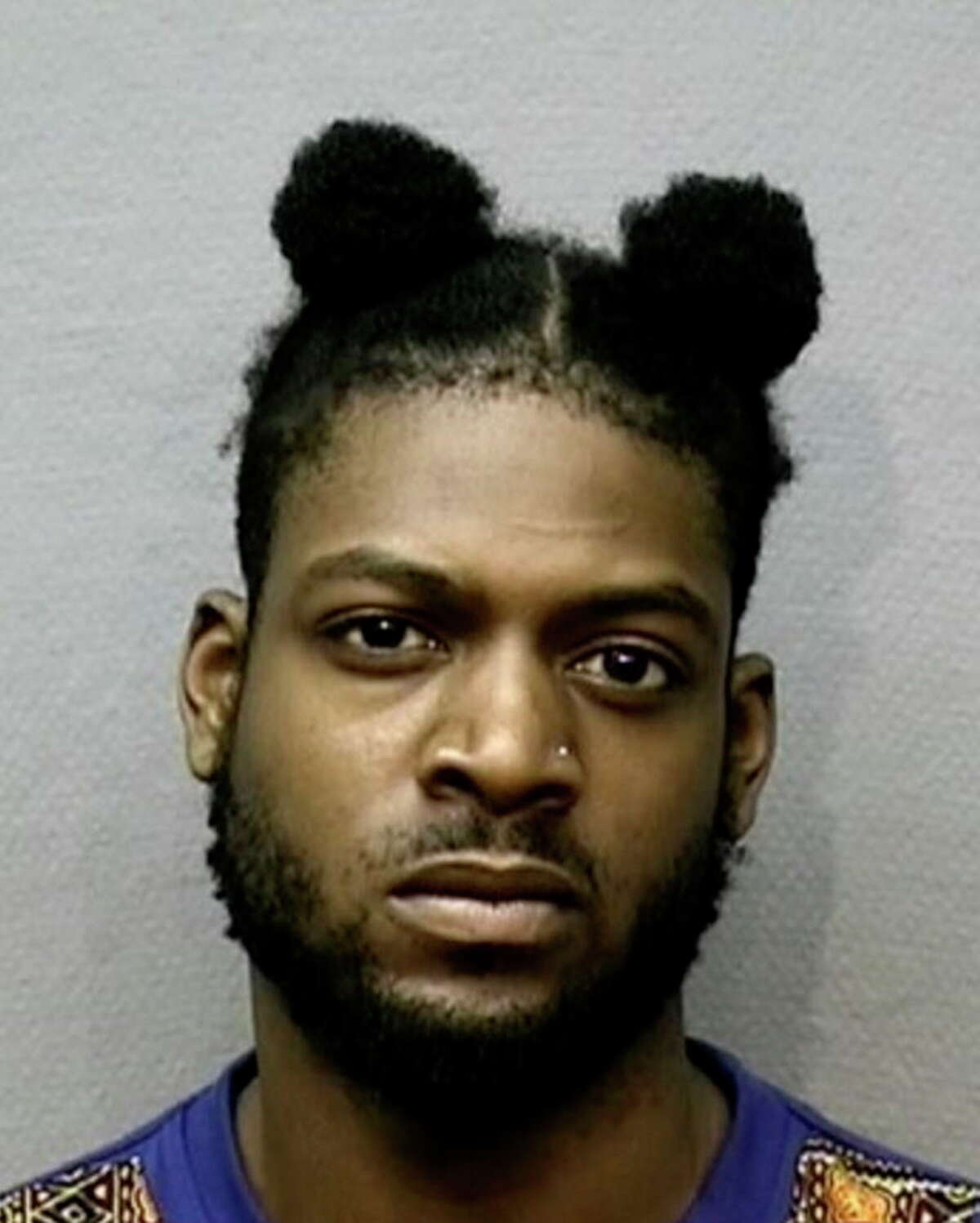 This undated photo provided by the Houston Police Department shows Jared Balogun. On Tuesday, June 20, 2017, police announced that Balogun has been charged with capital murder in the fatal shooting of a 10-month-old boy who was killed while his father was walking him outside an apartment complex. (Houston Police Department via AP)