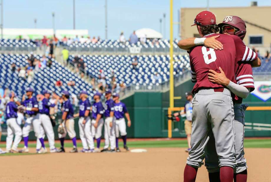 While the TCU players, left, congratulate each other on living to play another day, Texas A&M's Braden Shewmake (8) and Blake Kopetsky commiserate on the Aggies' season ending Tuesday at 41-23. Photo: Nati Harnik, STF / Copyright 2017 The Associated Press. All rights reserved.