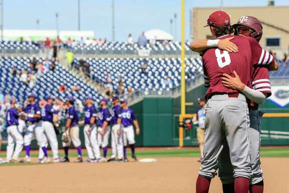 While the TCU players, left, congratulate each other on living to play another day, Texas A&M's Braden Shewmake (8) and Blake Kopetsky commiserate on the Aggies' season ending Tuesday at 41-23.