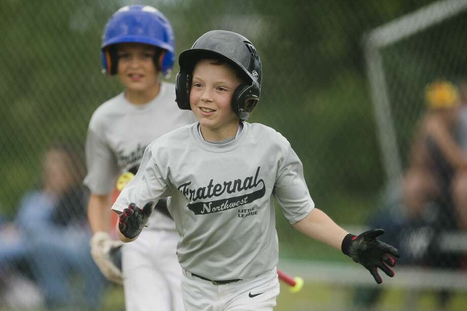 Jackson Larson celebrates a run during his team's 12-2 victory over Sowle Properties during the major Little League city championship game on Tuesday, June 20, 2017 in Midland. Photo: Katy Kildee | Kkildee@mdn.net