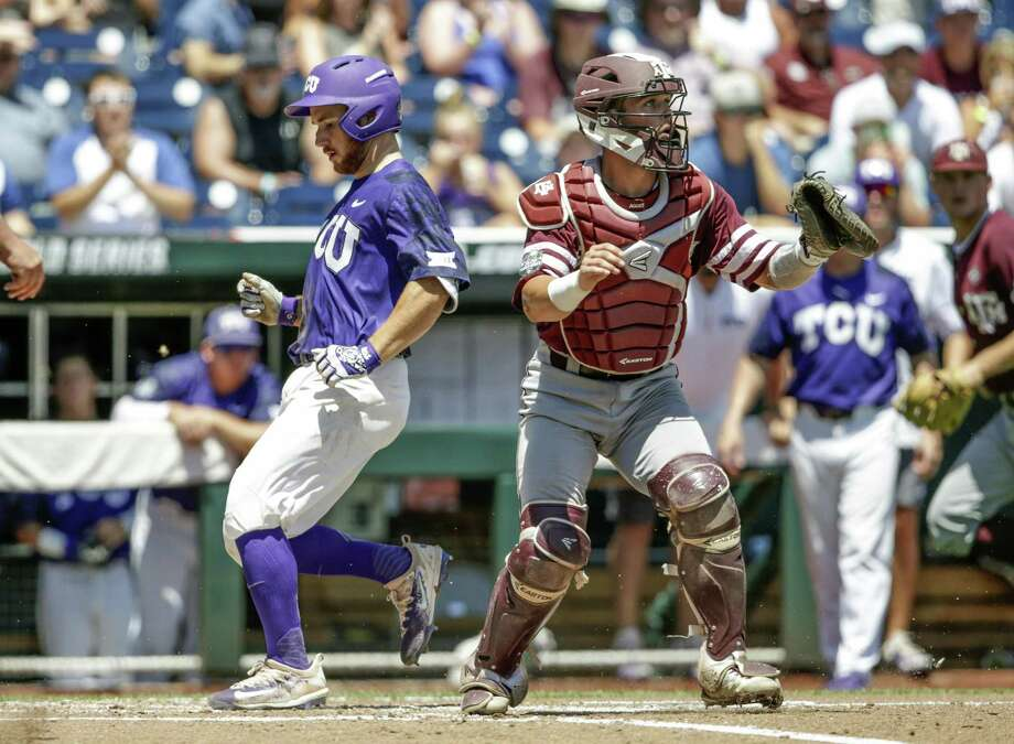 Zach Humphreys scores a run in the third inning as Texas A&M's Cole Bedford awaits a throw to the plate. The Frogs stayed alive and will face Louisville in another elimination game Thursday. Photo: Nati Harnik / Associated Press / Copyright 2017 The Associated Press. All rights reserved.