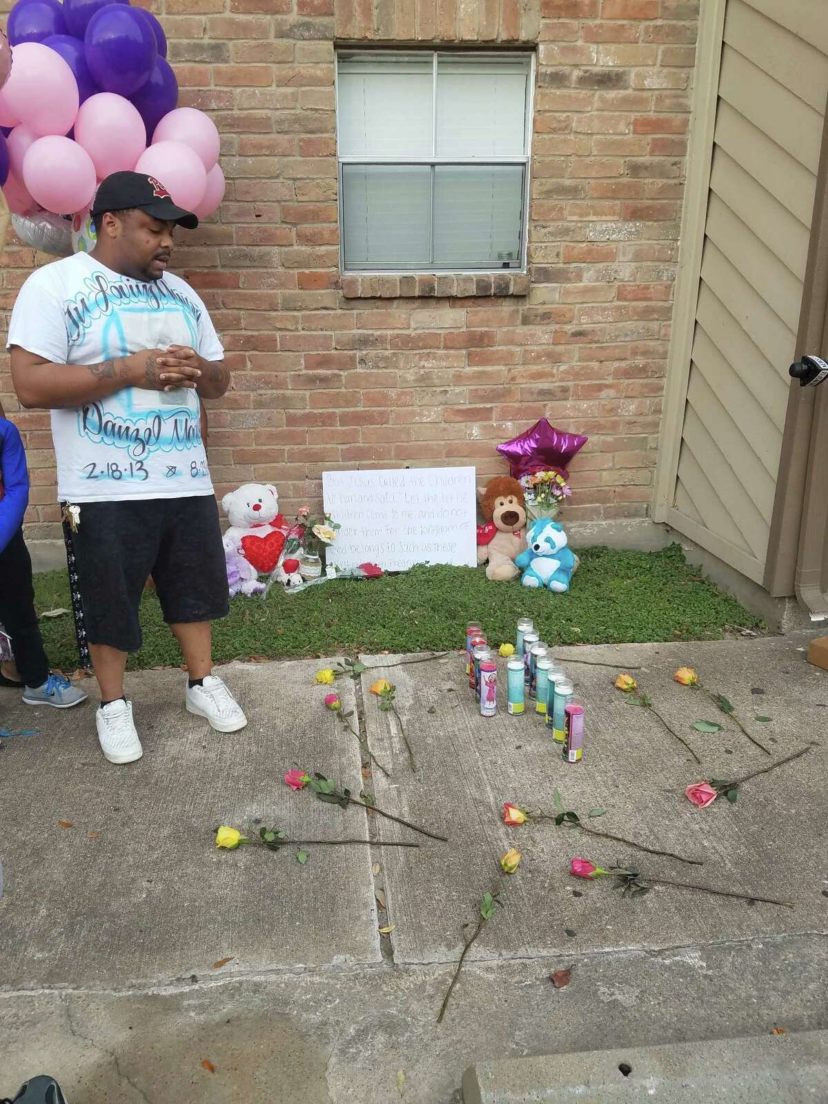 Randy Sample talks about his 4-year-old cousin Fredricka Allen during a vigil held at Timberwalk apartments where she was killed.